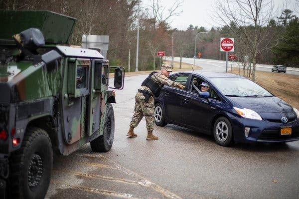 A member of the Rhode Island National Guard directed a car with New York license plates to a checkpoint.